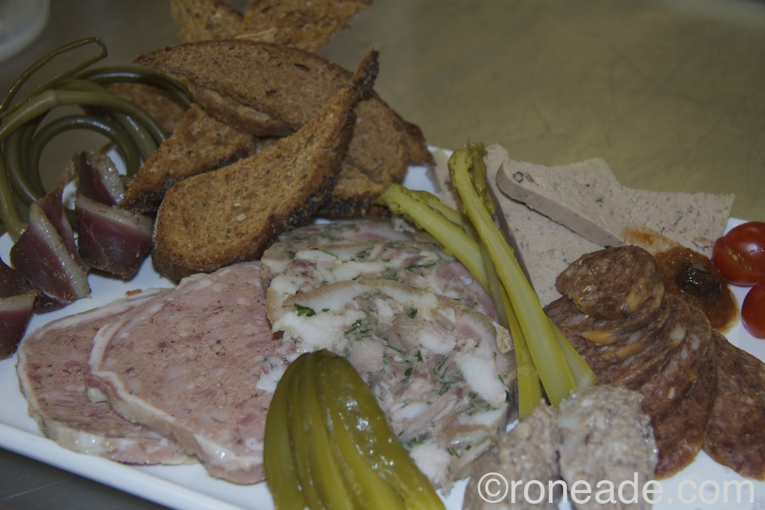 A charcuterie platter from the Algonquin College class. From left, duck prosciutto, country terrine, head cheese, cretons, chorizo, pate (top)