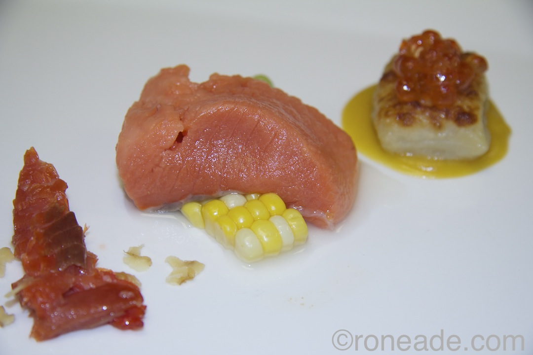By chef Mike Moffatt of Beckta, Play and Gezelling: Appetizer salmon three ways -- candied belly with shaved walnut and ginger reduction; marinated with avocado puree, corn, lime and sugar gastrique; caviar with potato gnocchi, chili-roasted squash.