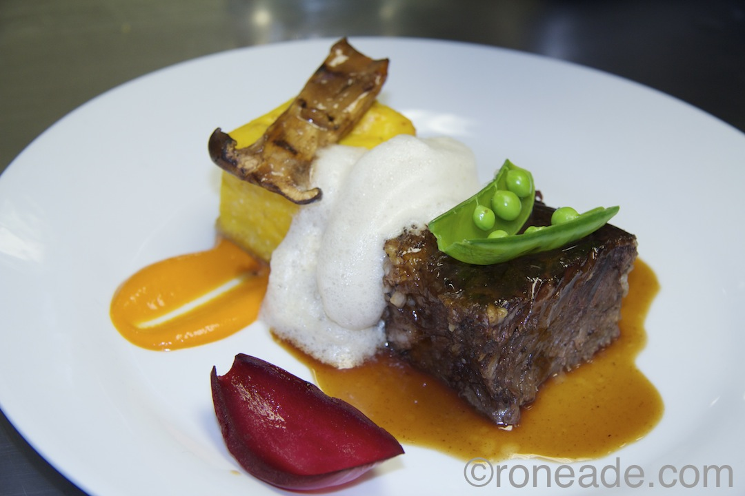 "Movie ""Land of the Lost"" plate by chef/owner Rob Bragagnolo of Marben Restaurant, Toronto: Confit beef rib, saffron polenta, beet, infused foam, porcini-rosemary sauce."